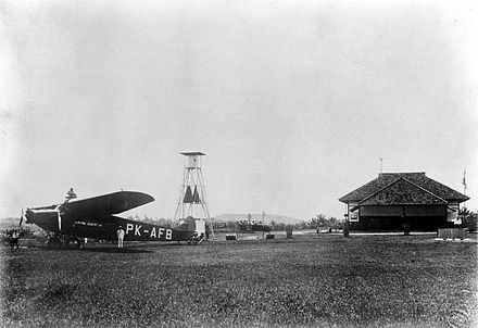 Van Lear Black with his plane in Batavia, 1927,