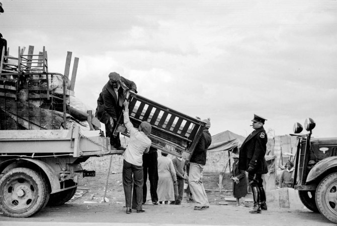State officials moving evicted sharecroppers away from roadside to Mississippi River spillway. New Madrid County, MO January 1939