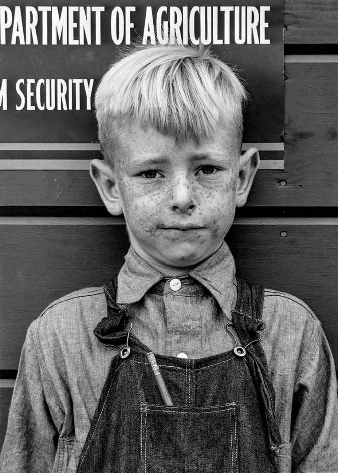Migrant boy Tulare FSA migrant camp Visalia, CA 1940