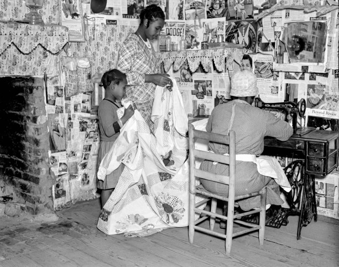 Sewing a quilt. Gees Bend, Alabama. 1937.