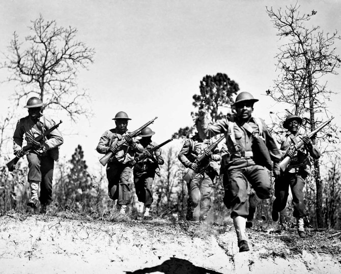 Sgt. Frank Williams, 41st Engineers, leading charge of his squad in training. 1942.