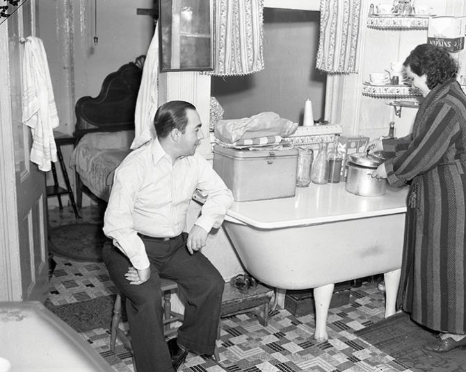 Family B. in old law tenement with bathtub in kitchen area. First Street. 1940.