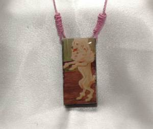 dancing dog domino necklace