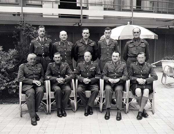 First Canadian Army generals in the Netherlands, on May 20 1945. Sitting, from left to right: Stanislaw Maczek, 1st Polish Armoured Division; Guy Simonds, II Canadian Corps; H.D.G. Crerar, 1st Canadian Army; Charles Foulkes, I Canadian Corps; B.M. Hoffmeister, 5th Armoured Division. Standing, from left to right: R.H. Keefler, 3rd Infantry Division; A.B. Matthews, 2nd Infantry Division; H.W. Foster, 1st Infantry Division; R.W. Moncel, 4th Armoured Brigade; S.B. Rawlins, 49th British Division.
