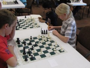 children play chess in a tournament in Utah
