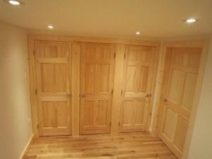 Bedroom closets and door to living room