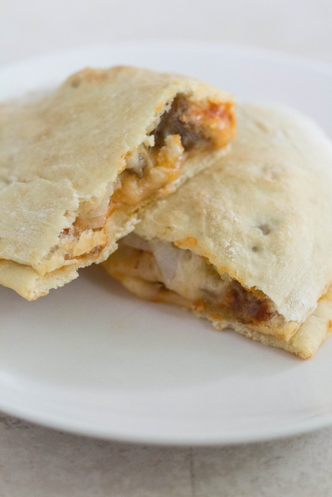 Pizza Calzones with Sausage, Pepperoni, and Onion | http://www.roseclearfield.com