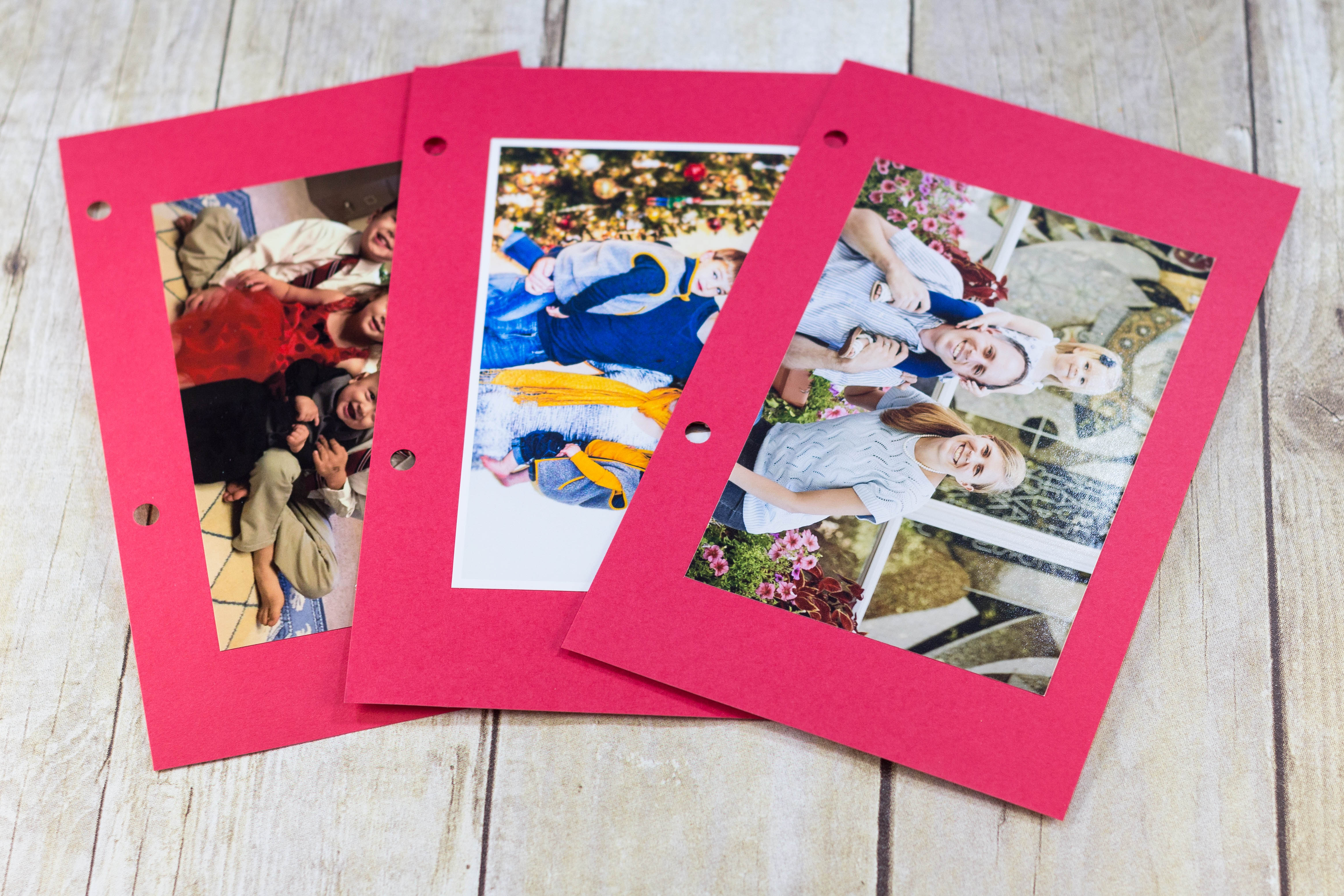 DIY Upcycled Christmas Card Books - I glue the photos to red cardstock. If there's a message or info on the back of the photos (i.e. kids' ages), you may want to write it on the cardstock. | http://www.roseclearfield.com