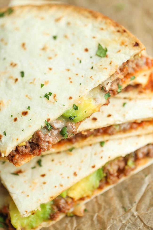 Cinco de Mayo Party Food Ideas - Cheesy Avocado Quesadillas via Damn Delicious | http://www.roseclearfield.com