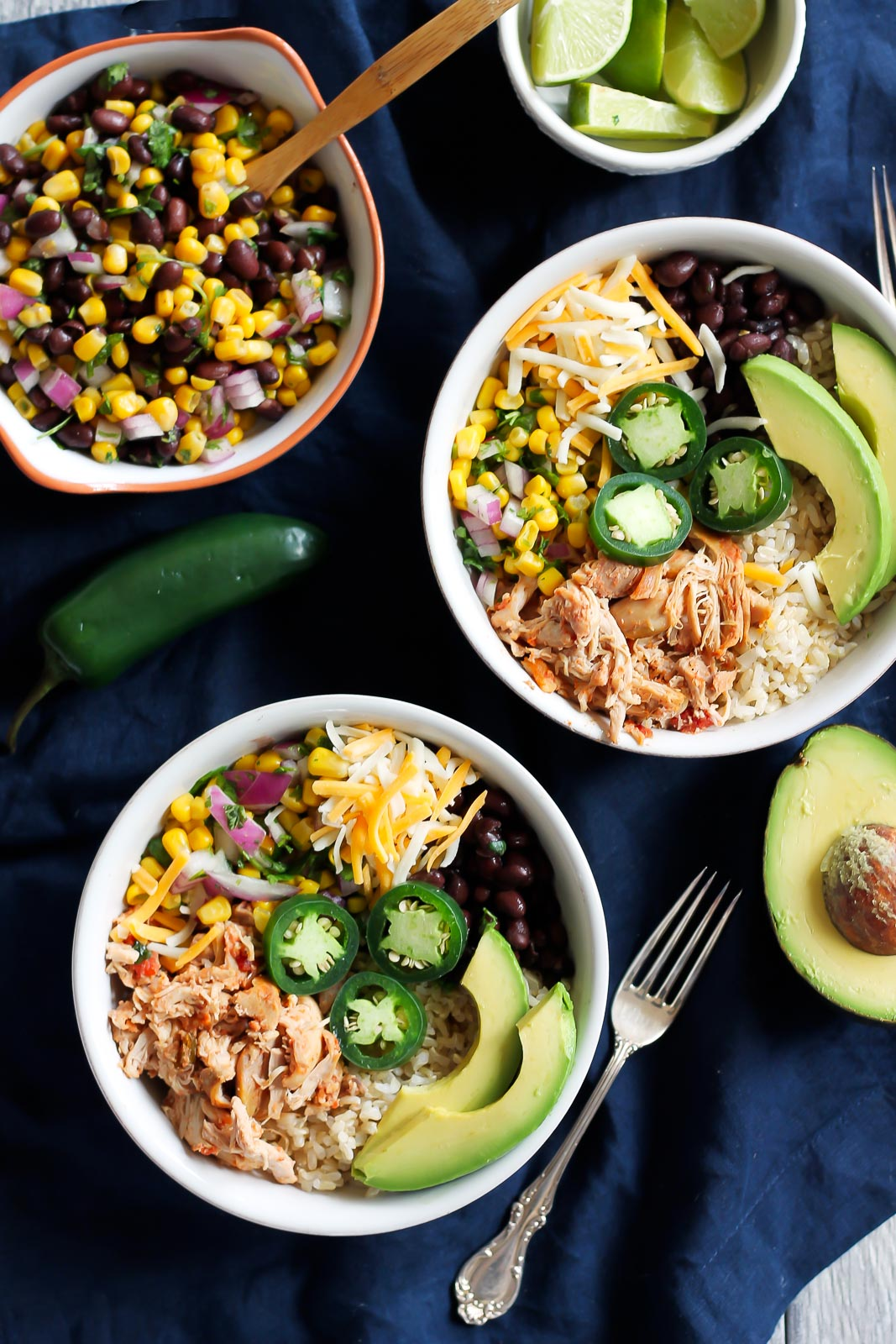 30 Days of Healthy Chicken Dinner Recipes - Chicken Burrito Bowls via Ambitious Kitchen | http://www.roseclearfield.com