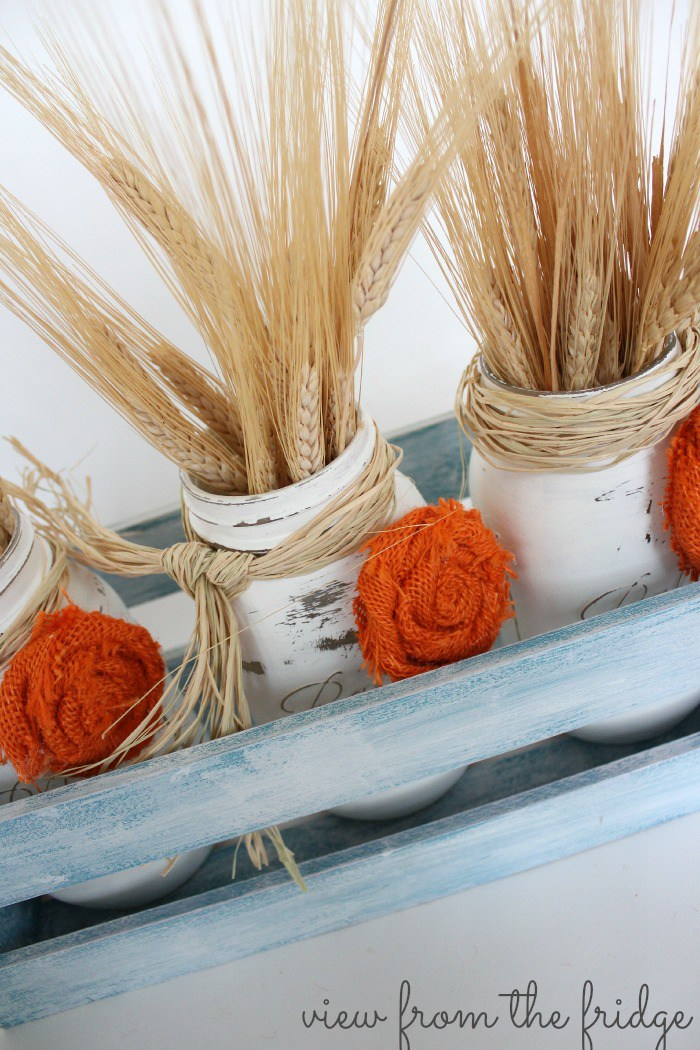 DIY Fall Mason Jar Decor - Fall Mason Jar Centerpiece with Burlap Rosettes via View From the Fridge via Oh My Creative | http://www.roseclearfield.com