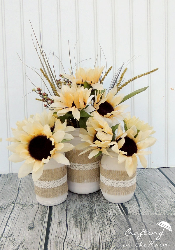 DIY Fall Mason Jar Decor - Fall Mason Jars with Burlap and Flowers via Crafting in the Rain | http://www.roseclearfield.com