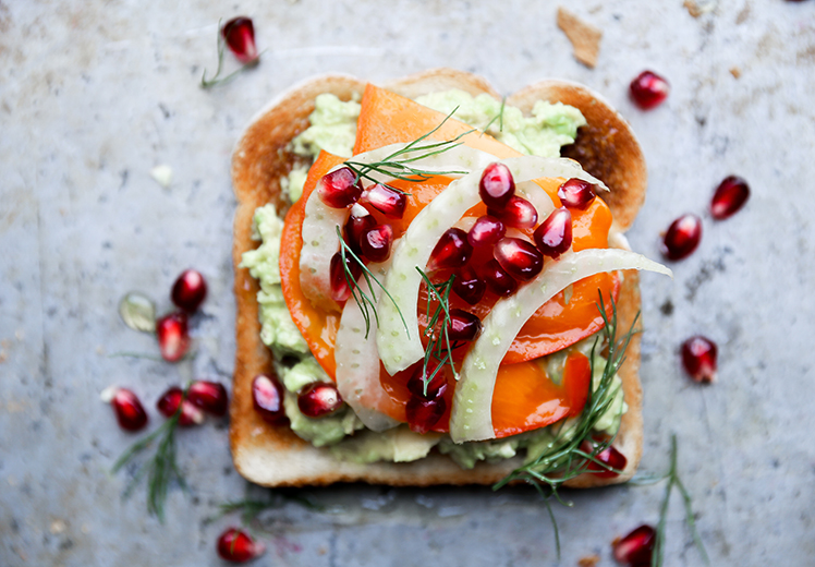 Fall and Winter Avocado Toast Recipes - Avocado Toast with Persimmon Pomegranate and Fennel via Floating Kitchen | http://www.roseclearfield.com