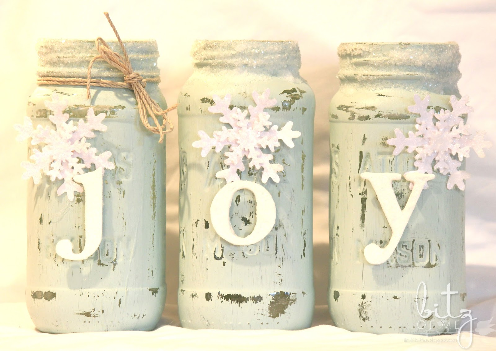 DIY Christmas Mason Jar Decor - Joy Painted Snowy Mason Jars via Tiny Bitz of Me | https://www.roseclearfield.com