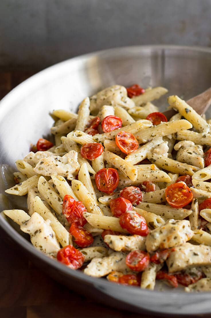30 Healthy Dinner Recipes for Two - Easy Pesto Chicken Pasta for Two With Oven Roasted Tomatoes via Baking Mischief | https://www.roseclearfield.com