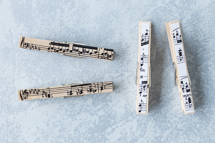 When you make DIY sheet music clothespin magnets, you can cut horizontal or vertical strips. #DIY #sheetmusic #clothespins | https://www.roseclearfield.com