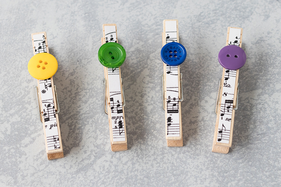 DIY sheet music clothespin magnets with fun button detail. #DIY #buttons #clothespins | https://www.roseclearfield.com