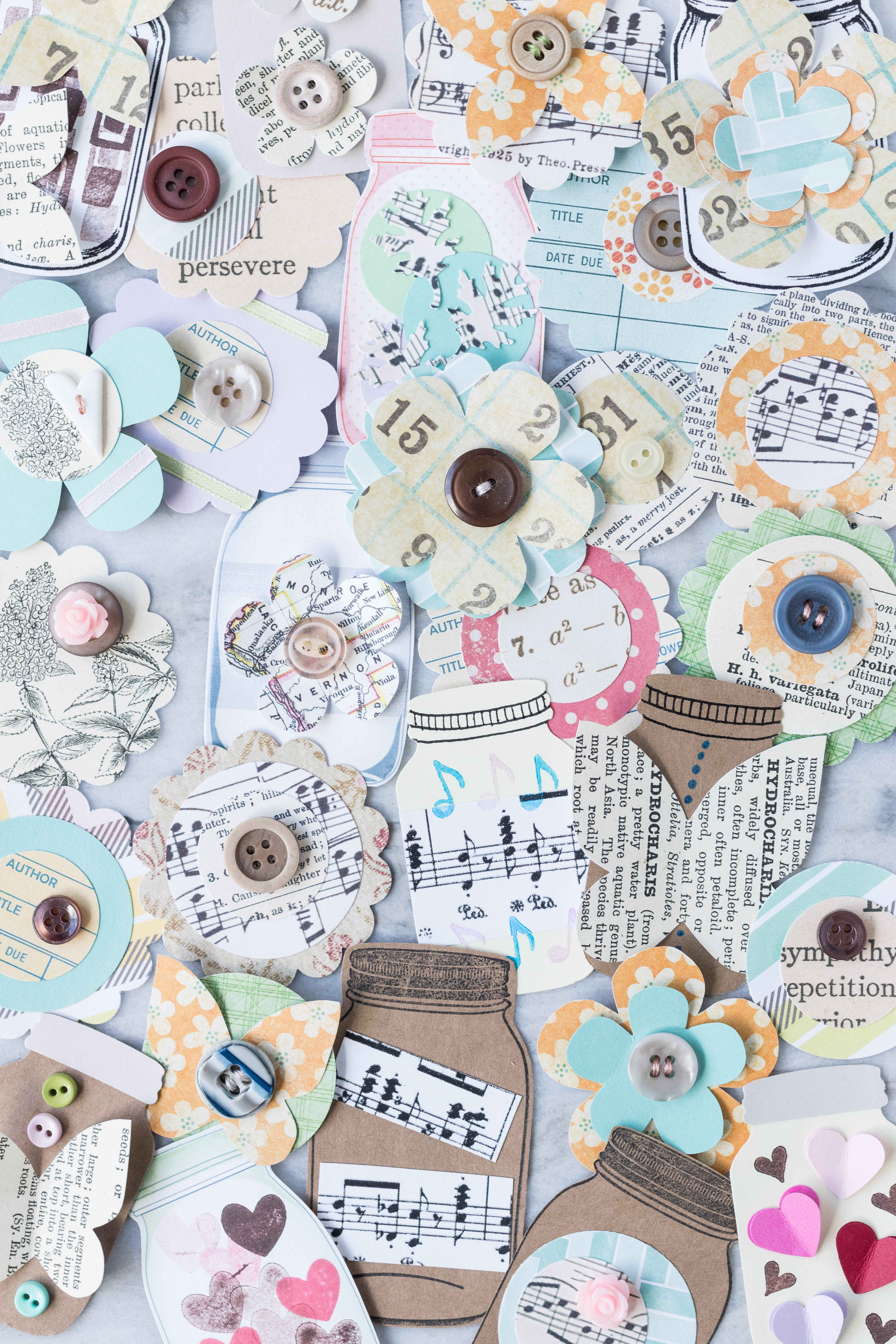Learn how to make your own scrapbook embellishments! DIY embellishments add a personal touch to scrapbook layouts as well as cards, gift tags, wrapping paper, junk journals, and much more! #DIY #scrapbooking #scrapbookembellishments | https://www.roseclearfield.com