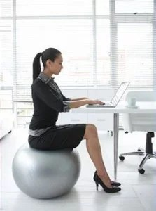 working woman on yoga ball chair