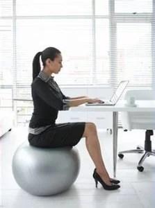 working woman on yoga ball chair