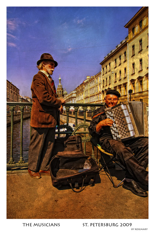 two elderly buskers on a canal in St. Petersburg