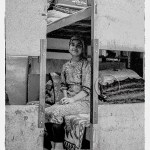 black and white portrait of a Uyghur girl in her factory dormitory