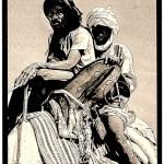 Mauritania: Sahara Desert caravan men ride double on camelback