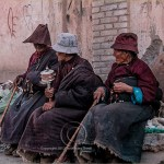 Tibetan woman pause in their prayers for a chat