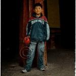 Tibetan boy at Drepung Monastery, Tibet