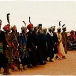 Niger: Wodaabe men dance and Wodaabe women watch