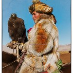 Kazakh man in traditional fur robes with his hunting eagle