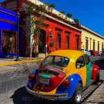 buildings and automobile painted in Oaxacan colors