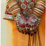 hands of an Indian bride with jewels and mendi