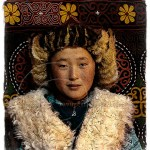 portrait of a Mongolian boy in fur hat and vest