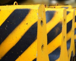 Black and yellow concrete barriers
