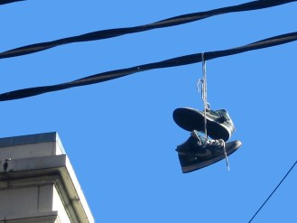 Shoes hanging from a wire