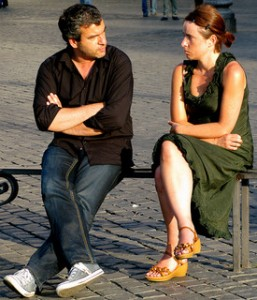 Two angry people sitting on a bench