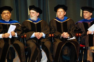 Four professors in cap and gown