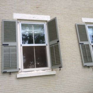 Rosslyn shutters loosened and flapping in the wind after July 19 thunderstorm.