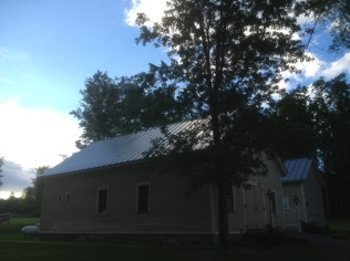 The new standing seam roof on Rosslyn's Carriage Barn is done at last. Hurray!