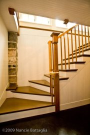 Rosslyn Stairway to Wine Cellar and Game Room (Credit: Nancie Battaglia)