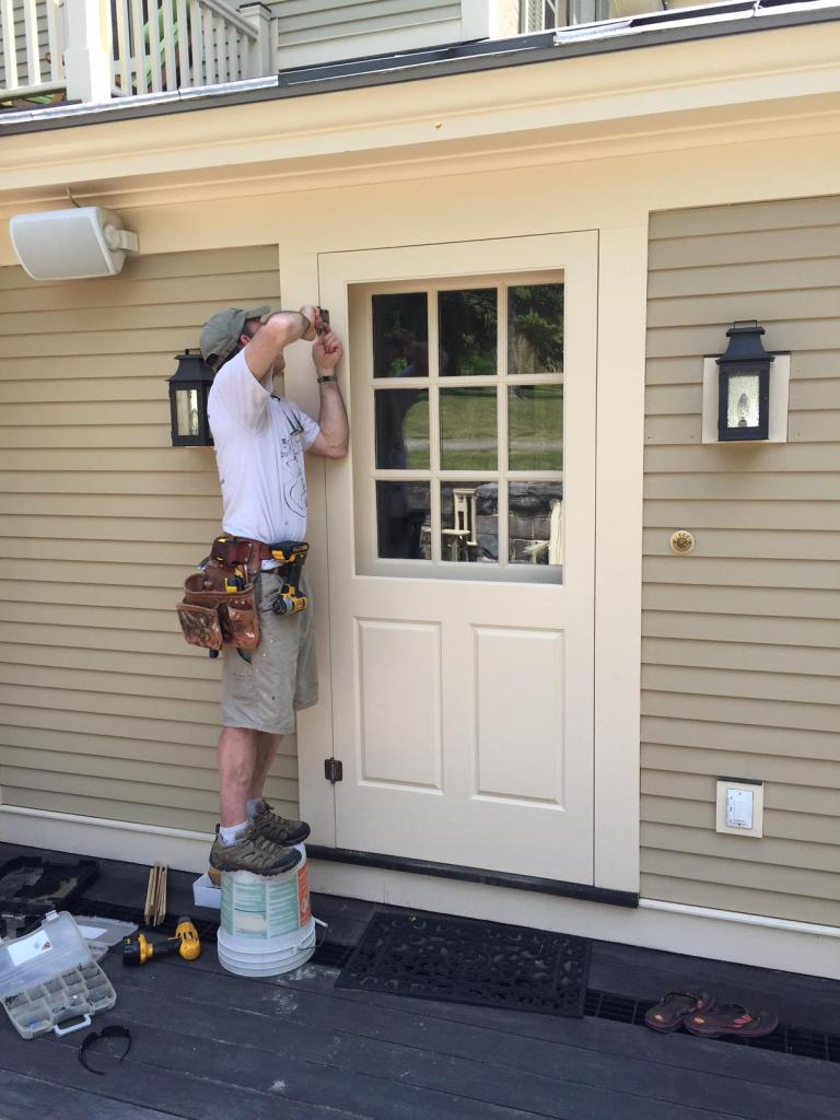 Kevin Boyle Installs New Screen Door