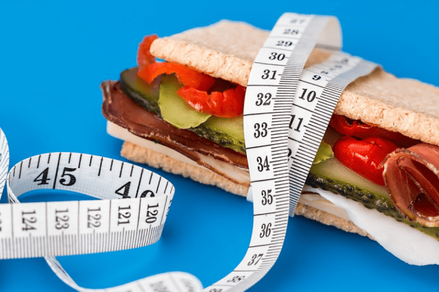 a healthy sandwich and a body meter