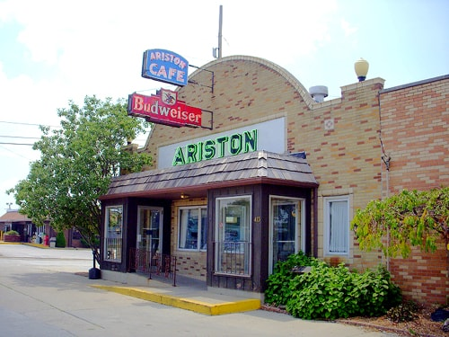 Relighting of Ariston Cafe's neon signs, windows set for May 4