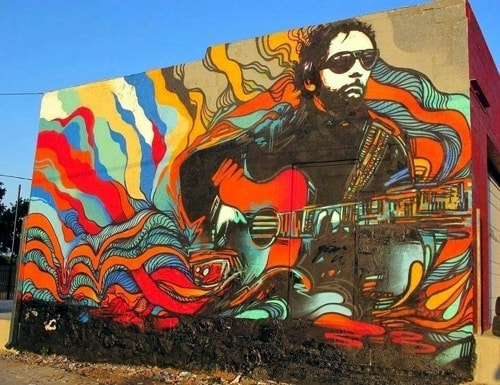 J.J. Cale mural at Soul City Gastropub lightly vandalized