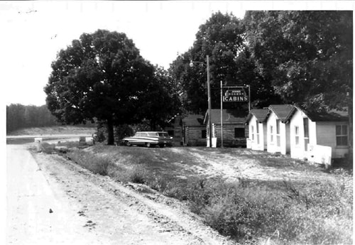 Vintage photo of John's Modern Cabins surfaces