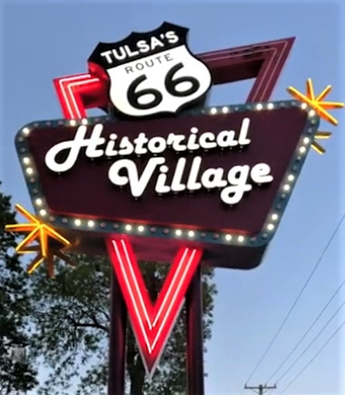 New Route Historical 66 Village neon sign lights the sky in Tulsa