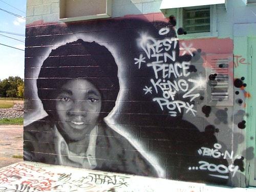 The story behind the many graffiti murals at Mad Dog Liquor in Tulsa