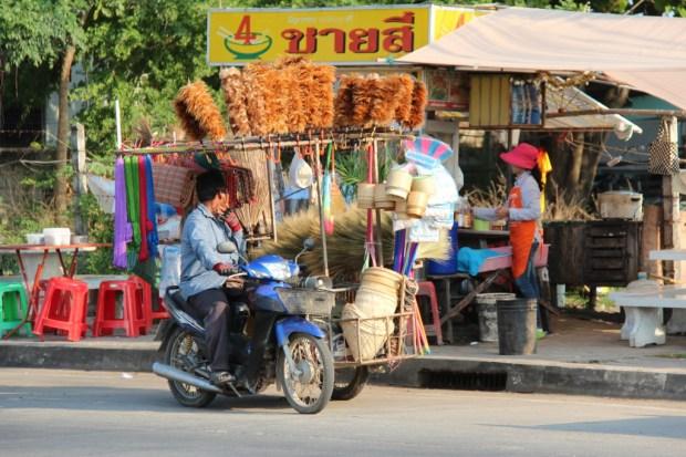Thai village life, a Ban Phe brush seller