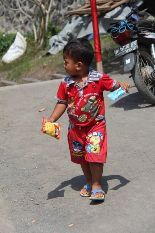 Drive in Central Bali, a Bali child